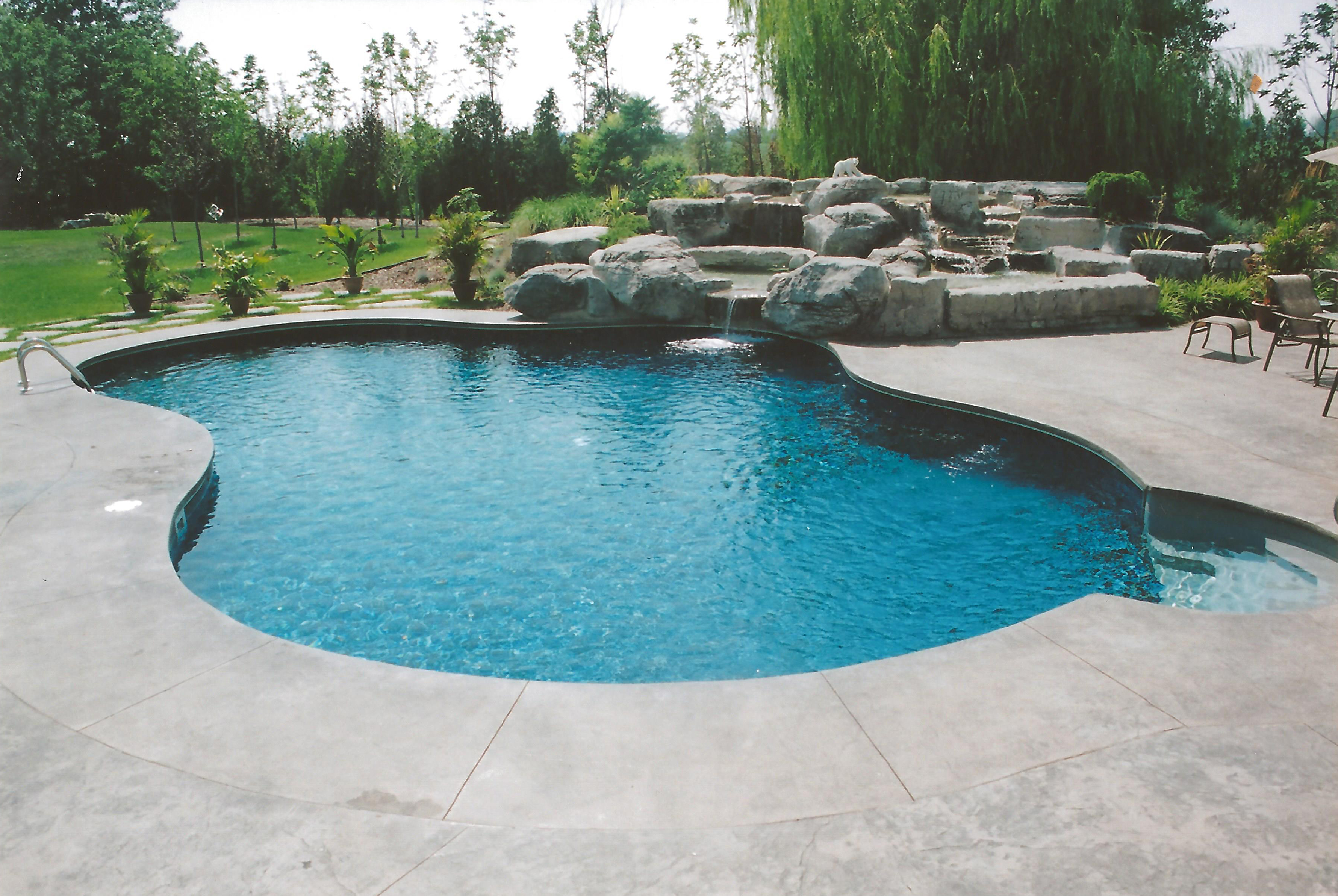 Beautiful pools top swimming pool designs small yards for Pool design 101